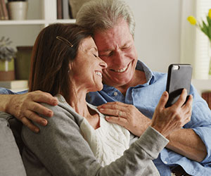 aging couple enjoying their smartphone
