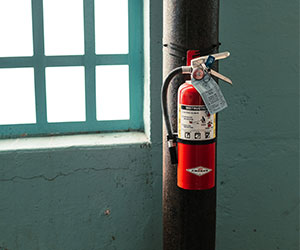 fire extinguisher mounted to pole