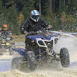 person riding 4-wheel ATV