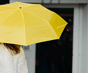 lady holding yellow umbrella